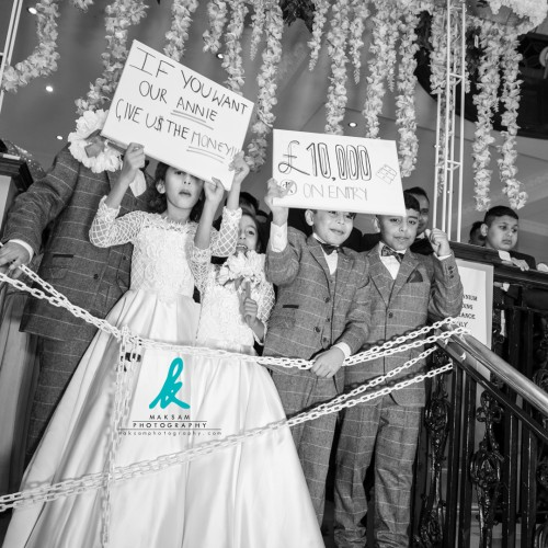 """""""If you want our Annie! Give us the money!!! £10,000 on entry!""""  This #WeddingGate is being held by the brides nephew's and neices at a #BengaliWedding.  https://www.maksamphotography.com/asian-wedding-photography  If you're looking for a #BengaliPhotographer for your #Wedding contact us today on 020 7193 3300 or simply Google MAKSAM #Photography for details 👆🏽  DM or visit the link in my profile for more information 👆🏽  Instagram: https://www.instagram.com/maksamphotography/ Facebook: https://www.facebook.com/maksamphotography Twitter: https://www.twitter.com/maksamphoto/ Pinterest: https://www.pinterest.com/maksamphoto/  #AsianWedding #AsianWeddingPhotography #BengaliWeddingPhotography #IndianWedding #IndianWeddingPhotography #MuslimWedding #MuslimWeddingPhotography #PakistaniWedding #PakistaniWeddingPhotography #AsianPhotographer #DesiPhotographer #BengaliPhotographer #CheapPhotographer #LondonWeddingPhotography #LondonWeddingPhotographer #LondonPhotography #KhalidPhotography #MAKSAMPhotography"""